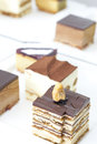 Small cube cake collection Royalty Free Stock Photo