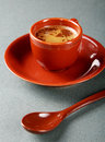 Small cup of coffee with a spoon and saucer Stock Photos