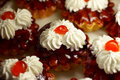 Small cupcakes with cream and cherry #1 Stock Images