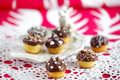 Small cute muffins covered chocolate decorated colorful sprinkles Stock Photo