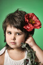Small dark-haired girl with red poppy