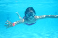 Small diver girl in the blue water Royalty Free Stock Photography