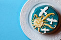Small easter blue cake with yellow sun and white doves in the white plate. Blue background. Royalty Free Stock Photo