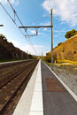 Small empty railroad station deserted railway platform Royalty Free Stock Image
