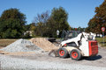 Small excavator bobcat on the construction site Stock Photography