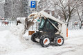 Small excavator bobcat working on the street Royalty Free Stock Photo