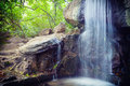 Small falls flow down from stones Royalty Free Stock Photo