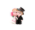 Small figurine of newlywed isolated couple in wedding outfits Royalty Free Stock Photos