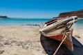 Small Fisherboat at the beach Stock Photo