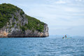Small fisherman boat near the rock island Royalty Free Stock Photo