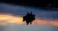 Small fishermen ship on a sundown lake Royalty Free Stock Photo