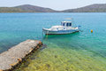 Small fishing boat at the coast of Crete Stock Images