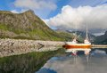 Small fishing boat in the harbor of the fjord Royalty Free Stock Photo