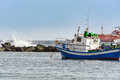 Small fishing boat at an ocean port of Santa Cruz town on Tenerife island, Spain. Royalty Free Stock Photo