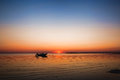 Small Fishing Boat at Sunset in Eastham, Cape Cod Massachusetts Royalty Free Stock Photo