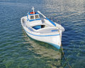 Small fishing boat turquoise sea greece Stock Photos