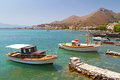 Small fishing boats on the coast of Crete Stock Photography