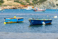 Small fishing boats off the coast in one of the bays europe mediterranean sea greece attica athens sounio beautiful nature Stock Images