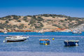 Small fishing boats off the coast in one of the bays europe mediterranean sea greece attica athens sounio beautiful nature Royalty Free Stock Image