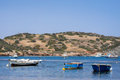 Small fishing boats off the coast in one of the bays europe mediterranean sea greece attica athens sounio beautiful nature Stock Photo