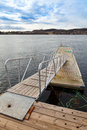 Small floating pier with ladder in norway Royalty Free Stock Photo