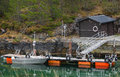 Small floating pier with moored motorboat in norway Royalty Free Stock Images