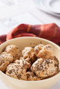 Small fresh buns with cumin in big bowl Royalty Free Stock Image