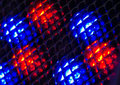 Small fresnel lens arranged in array with blue and red leds behind led lights Royalty Free Stock Photos
