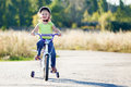 Small funny kid riding bike Royalty Free Stock Photo