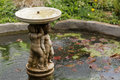 Small garden fountain in the rookery in streatham common park in london uk Stock Photo