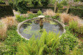Small garden fountain in the rookery in streatham common park in london uk Royalty Free Stock Images