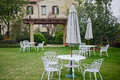 Small garden lawn placed white tables and chairs Royalty Free Stock Photo