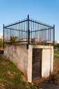 Small gate with fence goes to nowhere a steel on its top Royalty Free Stock Photography