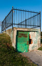 Small gate with fence goes to nowhere a steel on its top Royalty Free Stock Images