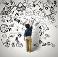 Small genius concept of with kid and varius drawings Stock Photo