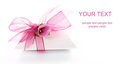 Small gift box decorated with ribbon Royalty Free Stock Image