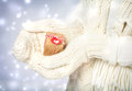 Small gift box in hands with white gloves handmade womans the snowing night Royalty Free Stock Images