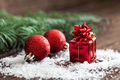 Small gift and christmas baubles Stock Photo
