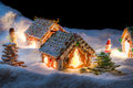 Small gingerbread cottage in winter at night Stock Image