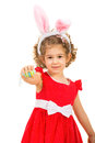 Small girl with bunny ears giving easter egg isolated on white background Stock Photos