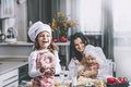 Small girl child eats a donut with my mom and sister happy cook Royalty Free Stock Photo
