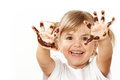 Small girl with chocolate smeared all over her face and fingers Stock Photography
