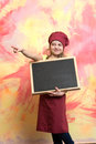 Small girl cook in hat with blackboard or chef child Royalty Free Stock Photo