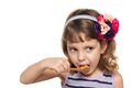 Small girl eats spoon white background Stock Photography