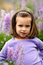 Small girl in a field of purple flowers. Stock Image