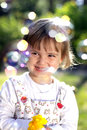 Small girl with a flower and soap bubbles Stock Photography