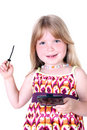 Small girl with liquid mascara Royalty Free Stock Photos