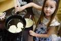 Small girl making pancakes mom teach daughter to cook little mothers helper Stock Photo