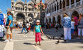 Small girl with pigeons in St Marco Square Royalty Free Stock Photography
