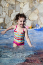 Small girl is playing in the swimming pool Royalty Free Stock Photography